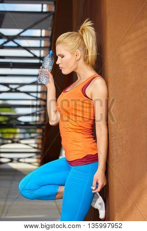 Female athlete women's sportswear fit thin physique athletic build outdoor city bridge portrait