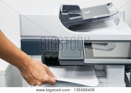 Close up printing and copying a document in the office