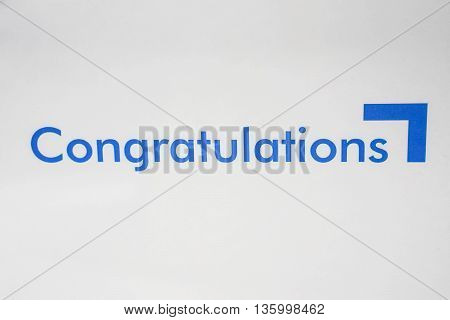 The word congratulations in blue color with white background