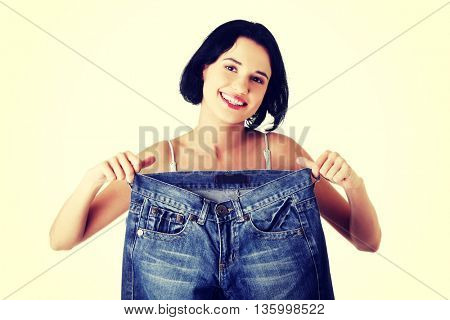 Young happy woman with big pants