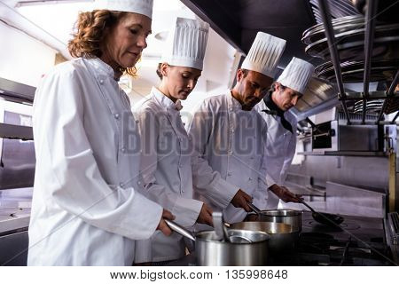 Chefs preparing food in restaurant kitchen