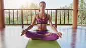 Fit Young Woman Meditating poster