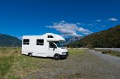 stock photo of campervan  - Campervan on a rest area on a sunny day - JPG
