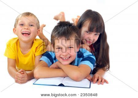 Three Kids Reading On Floor