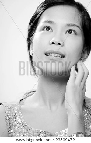 Pretty Asian Woman Deep In Thought