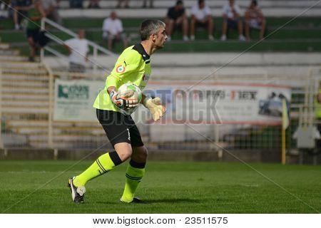 KAPOSVAR, HUNGARY - SEPTEMBER 10: Sasa Stevanovic in action at a Hungarian National Championship soccer game - Kaposvar (white) vs Gyor (green) on September 10, 2011 in Kaposvar, Hungary.