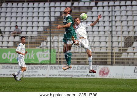 KAPOSVAR, HUNGARY - SEPTEMBER 10: David Hegedus (white 24) in action at a Hungarian National Championship soccer game - Kaposvar (white) vs Gyor (green) on September 10, 2011 in Kaposvar, Hungary.