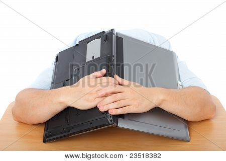 Portrait Of An Exhausted Businessman Covering His Head With His Laptop