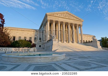 The front of the US Supreme Court in Washington, DC, at dusk.