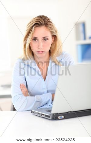 Office worker with bored look on her face