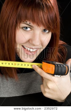 Redhead Girl Using Measuring Tape Tool