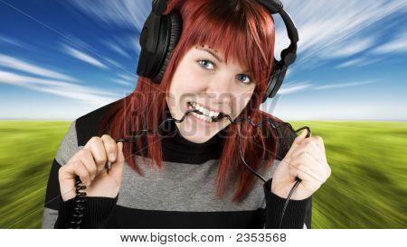 Girl Biting Headphone Cable