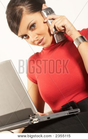 Atractive Brunet Businesswoman With Laptop And Phone