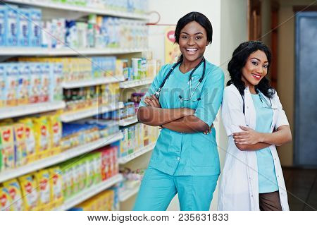 Two African American Pharmacist Working