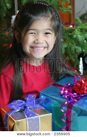 Six Year Old Girl Holding Her Christmas Presents