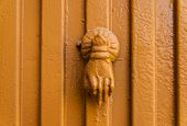Door With Brass Knocker In The Shape Of A Decor,  Beautiful Entrance To The House poster