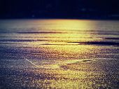 Ice Edge. Edge Of Orange Yellow Water Thawed From Under A Brilliant White Ice Floe. The Early Spring poster
