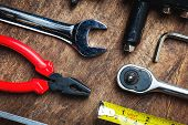 Set Of Construction Tools On Wooden Board As Wrench, Hammer, Pliers, Socket Wrench, Spanner, Tape Me poster