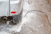 The Car Is In The Foam. Foam Car Wash. Foam Sticks With The Car. poster