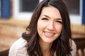 Portrait Of A Happy Hispanic Woman Smiling. poster