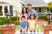 stock photo of 11 year old  - Hispanic family outside home - JPG