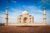 Taj Mahal. Indian Symbol and famous tourist destination - India travel background. Agra, India poster