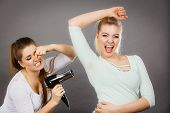 Woman Drying Her Female Friend Wet Armpit Using Hair Dryer. Getting Rid Of Sweat And Bad Smell, Hype poster