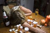 picture of overdose  - a woman commits suicide by overdosing on pills - JPG