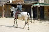 stock photo of forty-niner  - Cowboy in the traditional American western town - JPG