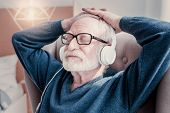 Absolute Relaxation. Nice Relaxed Aged Man Wearing Headphones And Closing His Eyed While Listening T poster