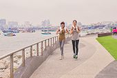Sports Concept. Beautiful Girl Is Exercising On The Beach With Running. Beautiful Girl Is Happy To E poster