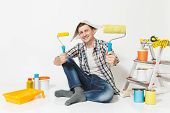 Man In Newspaper Hat Sitting On Floor With Paint Rollers, Instruments For Renovation Apartment Room poster