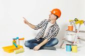 Man In Orange Protective Helmet Pointing Index Finger Aside On Copy Space. Instruments For Renovatio poster