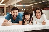 Lovely Bearded Man, Together With His Beautiful Wife And Son, Relaxes On The Mattress In The Store.  poster