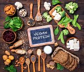 Vegan protein sources. Top view on a brown wooden background poster