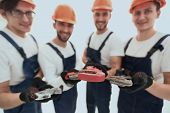 image of a group of builders with gas keys poster