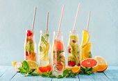 Variety Of Fruit Infused Detox Water In Small Bottles. Set Of Refreshing Summer Drinks. Healthy Diet poster