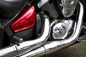 stock photo of straddling  - Side view of a custom motorcycle engine - JPG