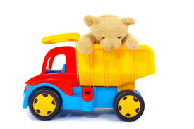 pic of dump_truck  - Stuffed toy bear riding in the back of a colorful toy dump truck - JPG