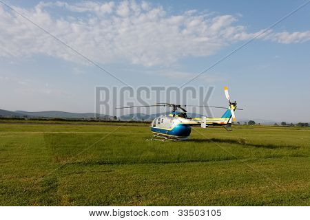 A Helicopter Standing In An Airfield