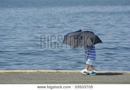 Boy with umbrella