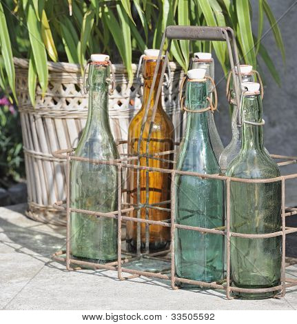 Old colored stopper bottles on doorstep