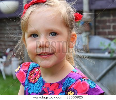 Adorable young girl with a cheeky smile