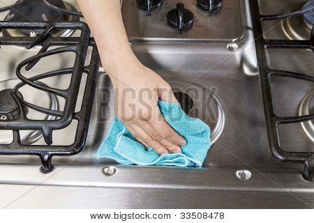 Wiping Down Stove Top Range