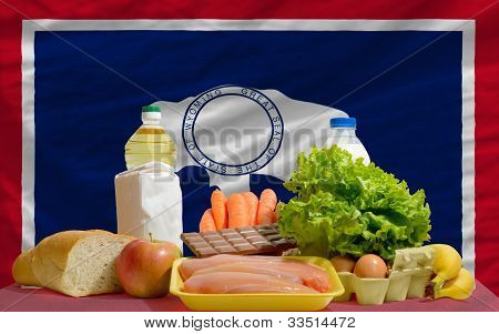 Basic Food Groceries In Front Of Wyoming Us State Flag