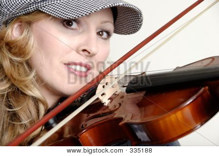 Woman Playing The Violin Up Close