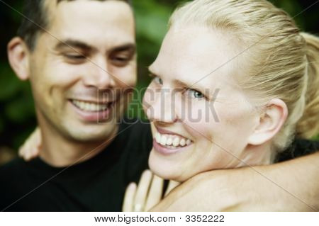 Hispanic Man And Blonde Woman