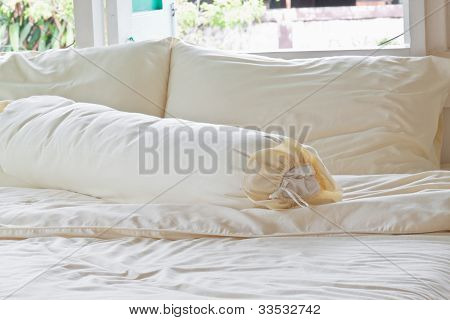 Messy Bed With White Pillows