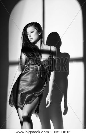 Woman In Nightdress With Light Of Window