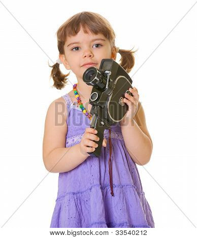 Curious Child With An Old Movie Camera